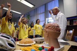 Dr. Tator talks about brain injuries to children at McMurrich Junior Public School