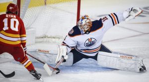 Koskinen makes a split save against the Calgary Flames