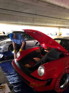 Michael Gilson cleaning his Speedster
