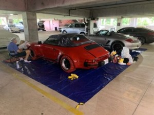 Michael putting the final touches on the Speedster in the Concours preparation area