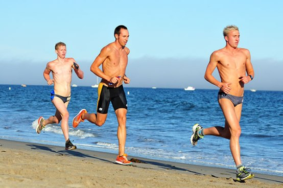 The top three, led by Cuyler Gabriel, in the 5-mile beach biathlon.