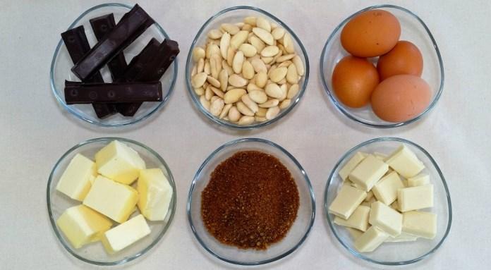 Ingredientes bizcocho almendrado cobertura chocolate blanco, chocolate fondant, almendras, huevos, mantequilla, azúcar y chocolate blanco