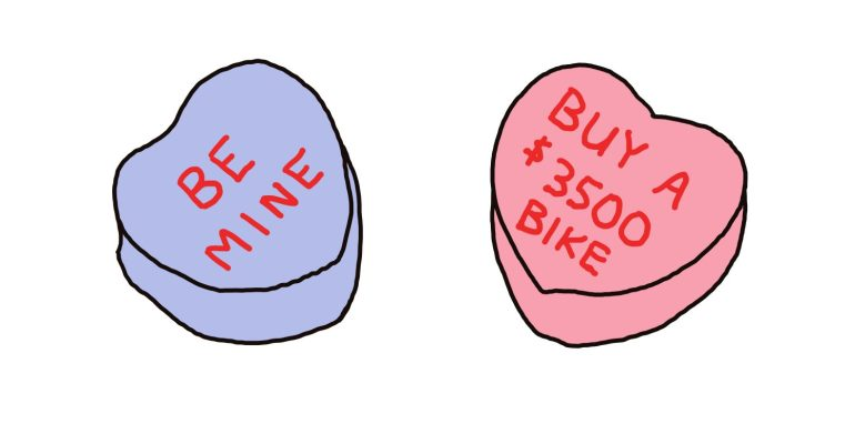 "drawing of candy hearts saying ""be mine"" and ""buy a $3500 bike"""