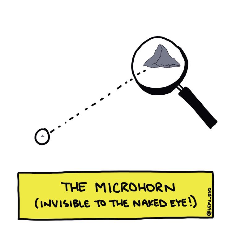 drawing of a miniature matterhorn under a magnifying glass
