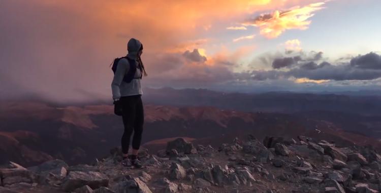 photo of woman on summit of Torreys Peak Colorado