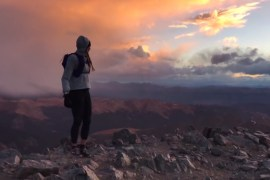 photo of woman on summit of Torreys Peak Colorado