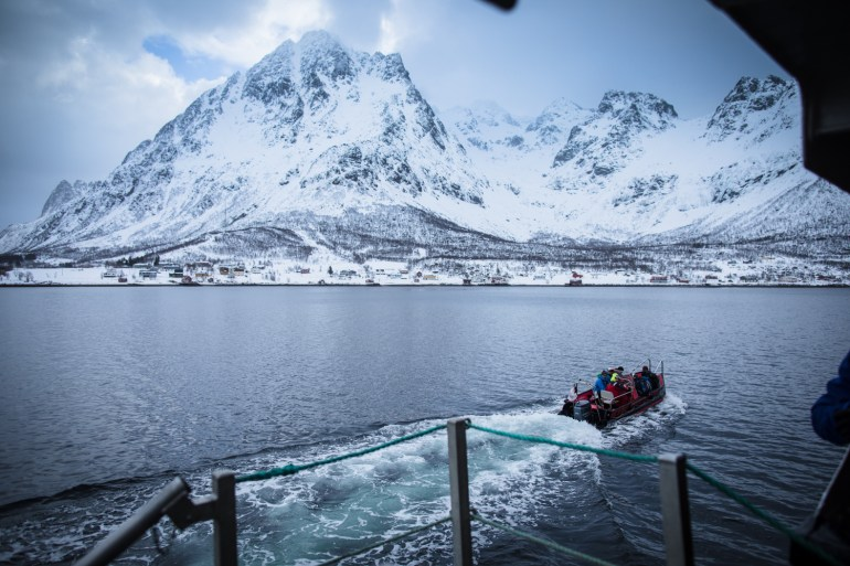 Tommy Penick photo of a tender boat taking skiers to shore on the Arctic Haute Route in Norway