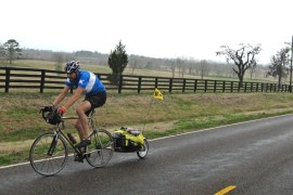 cyclist riding a touring bicycle in east texas in 2010