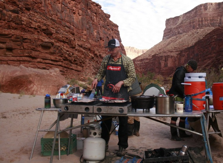 david marx cooks breakfast at a river campsite in the grand canyon