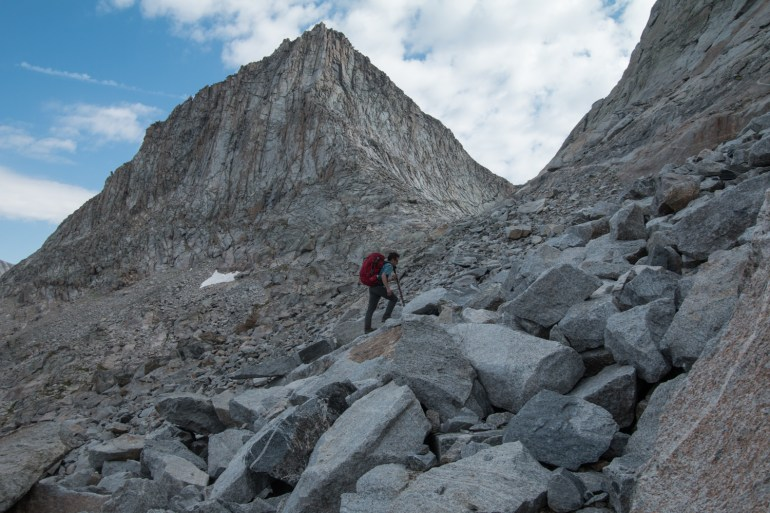 Brendan Leonard hikes up a talus field to Angel Pass in the Wind River Range.