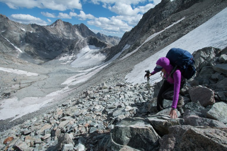 Hilary Oliver scrambles down from Knapsack Col into Titcomb Basin in Wyoming's Wind River Range