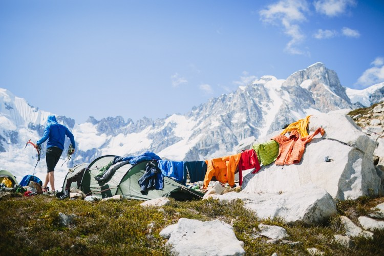 forest woodward photo of climber drying clothes at alpine campsite