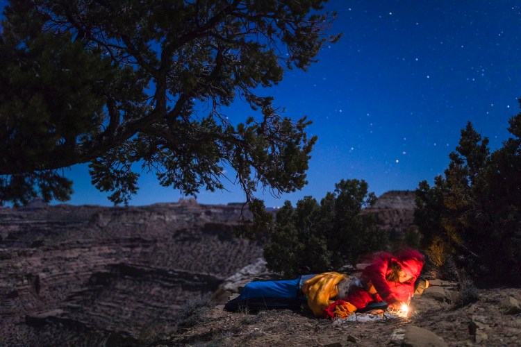 forest woodward photo of camper going to sleep in bivy sack