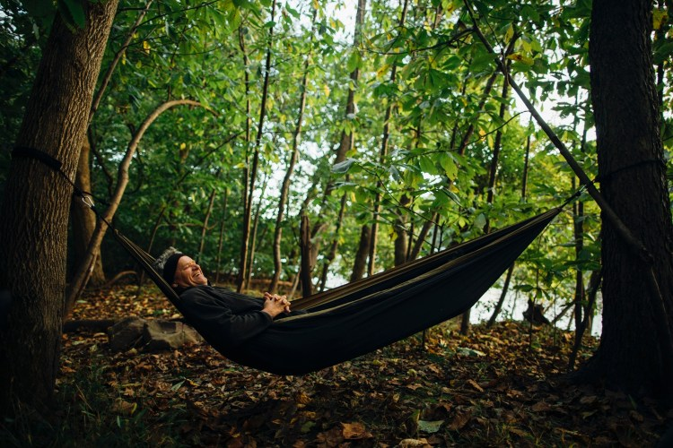 forest woodward photo of camper in hammock among trees