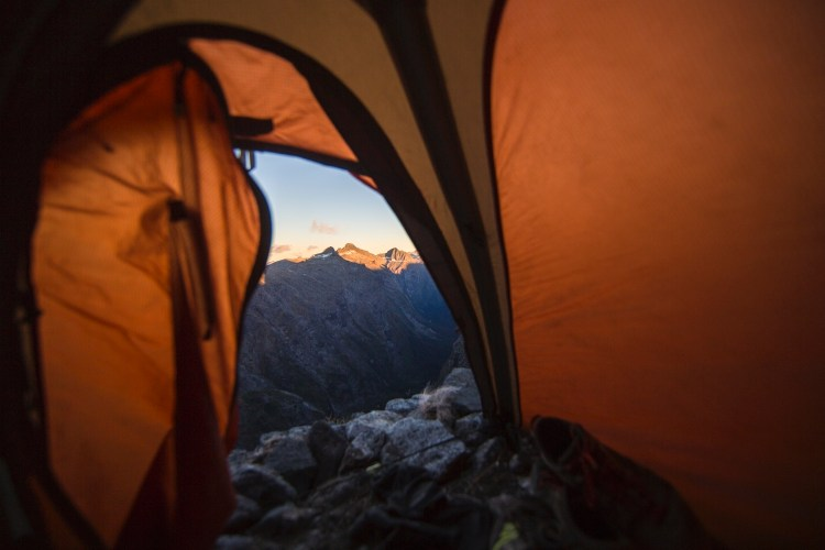 forest woodward photo of view out tent door toward mountains
