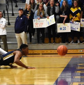 Ronnie Buford dives for a loose ball