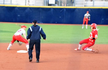 Lilli Piper waits for the runner to apply the tag