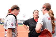 Coach talks between innings with her pitcher, Shelby McCombs & catcher