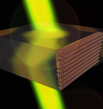 """This graphic depicts a device created using """"negatively refracting metamaterials"""" that could bring advances in applications including sensing, imaging, data storage, solar energy and optics. Purdue researchers are working on a range of options to overcome a fundamental obstacle in commercializing the materials. The small spheres at right represent a lattice of """"meta-atoms"""" carefully designed and fabricated to produce a high-performance device. (Source: Birck Nanotechnology Center/Purdue University)"""