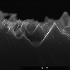 Rice University scientists have reduced to one step the process to turn silicon wafers into the black silicon used in solar cells. The advance could cut costs associated with the production of solar cells. Here, a cross section shows inverted pyramids etched into silicon by a chemical mixture over eight hours. (Source: Rice University)