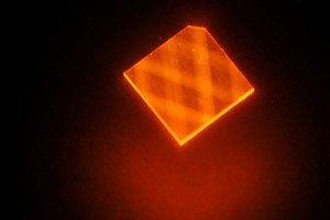 """In this image, laser light enters a synthetic diamond from a facet at its corner and bounces around inside the diamond until its energy is exhausted. This excites """"nitrogen vacancies"""" that can be used to measure magnetic fields. (Source: MIT)"""