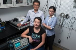 Rice University researchers (clockwise from front) Man-Nung Su, Wei-Shun Chang and Fangfang Wen discovered a new method to tune the light-induced vibrations of nanoparticles through slight alterations to the surface to which they are attached. (Source: Rice University)