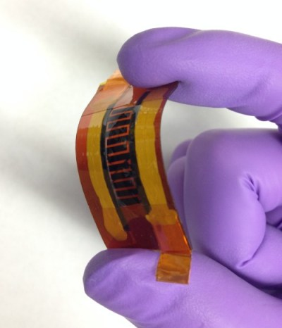 """Rice University scientists made this supercapacitor with interlocked """"fingers"""" using a laser and writing the pattern into a boron-infused sheet of polyimide. The device may be suitable for flexible, wearable electronics. (Source: Tour Group/Rice University)"""