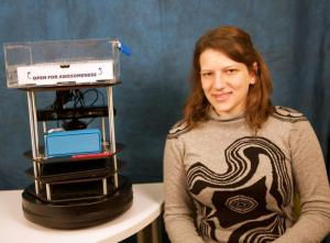 Serena Booth and her robot, Gaia, in its cookie-delivery disguise. (Source: Harvard University)