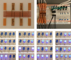 """Duke University researchers have developed a new """"spray-on"""" digital memory (upper left) that could be used to build programmable electronics on flexible materials like paper, plastic or fabric. They used LEDS to demonstrate a simple application. (Source: Duke University)"""