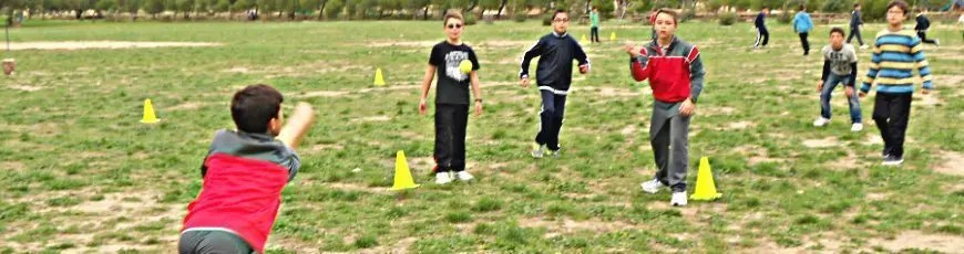 A group of grade 7 students play rounders at Ta'Qali gounds furing the live-in.