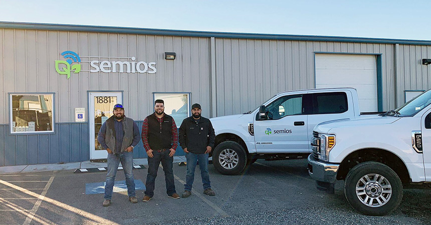 Members of the Semios team standing outside the office
