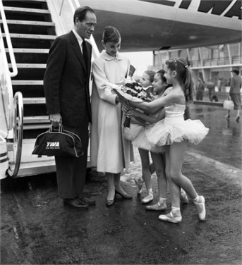 02 Jun 1956, Paris, France --- Tiny ballerinas from the Paris Opera give a big welcome and a bouquet to actress Audrey Hepburn as she arrives at the Paris airport with her husband, actor Mel Ferrer. Audrey's in the French capital to film a Hollywood movie called . --- Image by © Bettmann/CORBIS