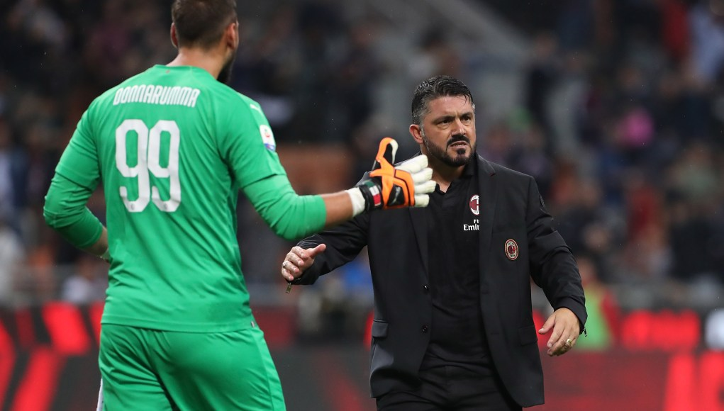 MILAN, ITALY - AUGUST 31: AC Milan coach Gennaro Gattuso (R) celebrates victory with Gianluigi Donnarumma (L) at the end of the serie A match between AC Milan and AS Roma at Stadio Giuseppe Meazza on August 31, 2018 in Milan, Italy. (Photo by Marco Luzzani/Getty Images)