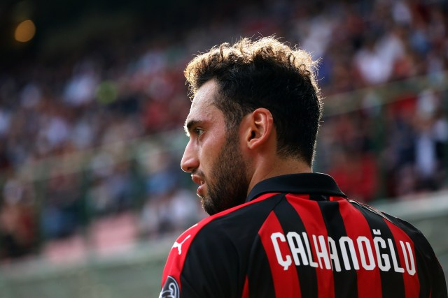 MILAN, ITALY - OCTOBER 07: Hakan Calhanoglu of AC Milan looks on during the Serie A match between AC Milan and Chievo Verona at Stadio Giuseppe Meazza on October 7, 2018 in Milan, Italy. (Photo by Marco Luzzani/Getty Images)