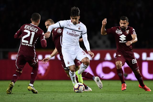AC Milan's Brazilian midfielder Lucas Paqueta (C) fights for the ball with Torino's Spanish forward Alejandro Berenguer (L) during the Italian Serie A football match between Torino and AC Milan on April 28, 2019 at the Grande Torino stadium in Turin. (Photo by MARCO BERTORELLO / AFP) (Photo credit should read MARCO BERTORELLO/AFP/Getty Images)