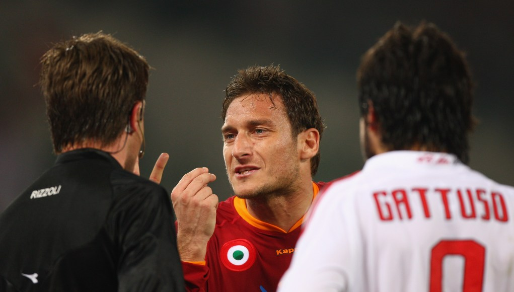 ROME - MARCH 15: Francesco Totti (centre) of Roma argues with the referee as Gennaro Gattuso (right) of Milan looks on during the Serie A match between Roma and AC Milan at the Olympic Stadium on March 15, 2008 in Rome, Italy. (Photo by Michael Steele/Getty Images)