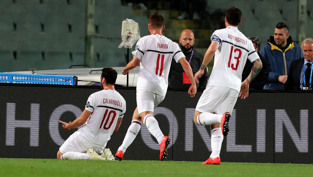 FLORENCE, ITALY - MAY 11: Hakan Calhanoglu of AC Milan celebrates after scoring a goal during the Serie A match between ACF Fiorentina and AC Milan at Stadio Artemio Franchi on May 11, 2019 in Florence, Italy. (Photo by Gabriele Maltinti/Getty Images)