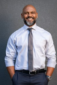 african-american-businessman-smiling-on-grey-picture-id1138563417