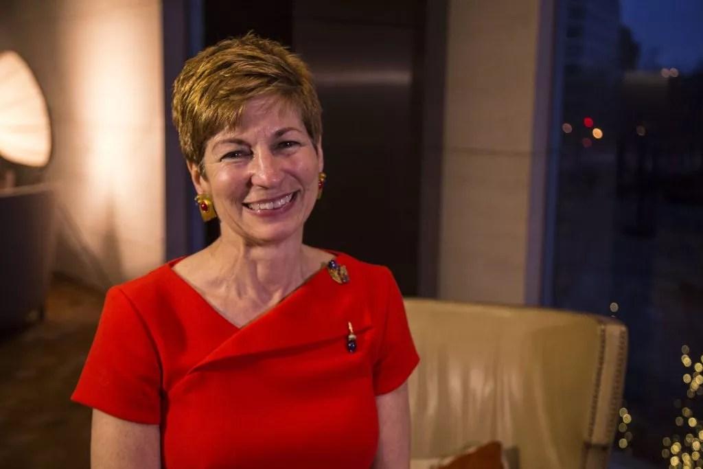Juniper CEO Lynne Katzmann in red dress