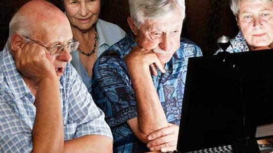 seniors-huddled-around-computer