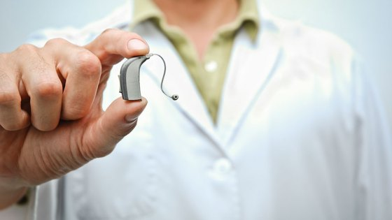 doctor-holding-hearing-aid