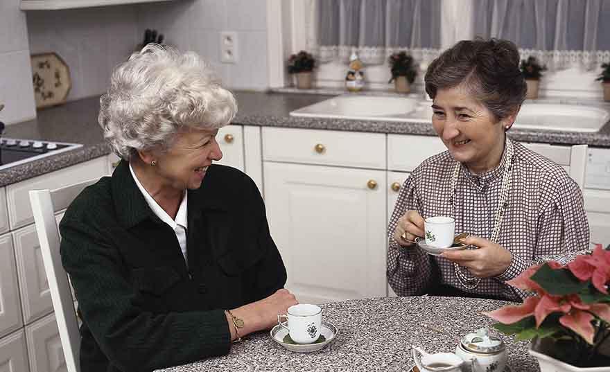 Women having tea in kitchen