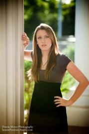 Brunette female model senior portraits column backlit photo
