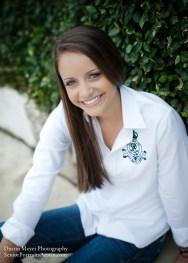 Brunette teen female smile senior portraits white button shirt blue jeans photo