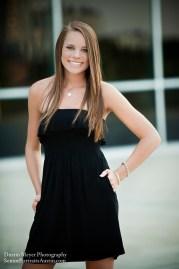Dirty blonde teen female model senior portraits black strapless dress Long Center for Performing Arts smile