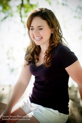 Brunette teen female model laughing laughs senior portraits photo