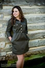 Brunette teen female model senior portraits log cabin button dress smile