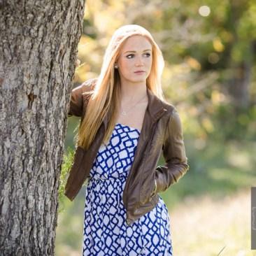 Senior portraits photo photography blond hair female blue eyes blue dress brown jacket tree outdoors natural light senior portraits ideas