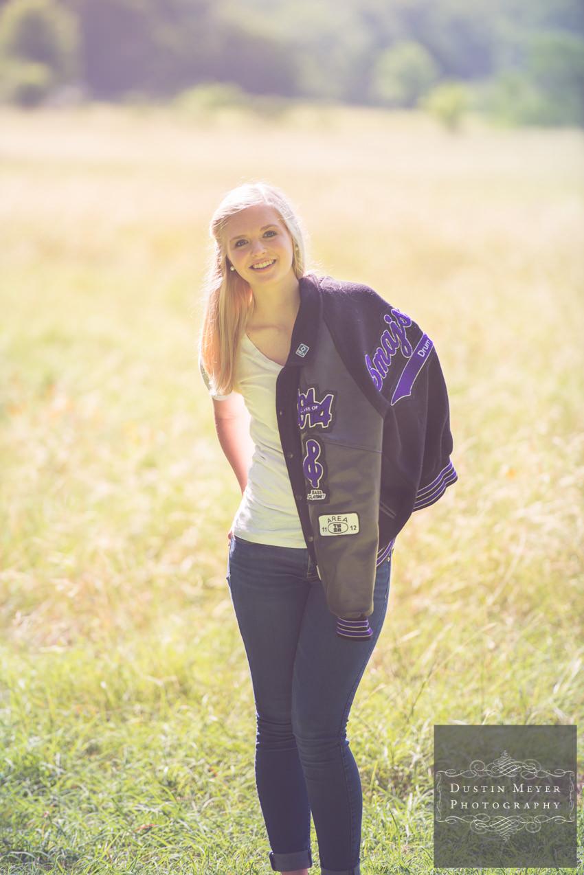senior portraits ideas outdoor letter jacket photos cedar ridge
