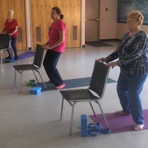 Women doing chair yoga